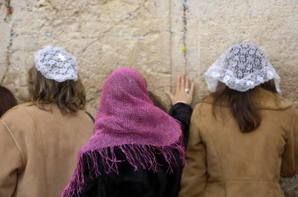 Image of three women at the wailing wall