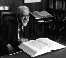 Image of Rabbi Mordecai Kaplan studying from a book.