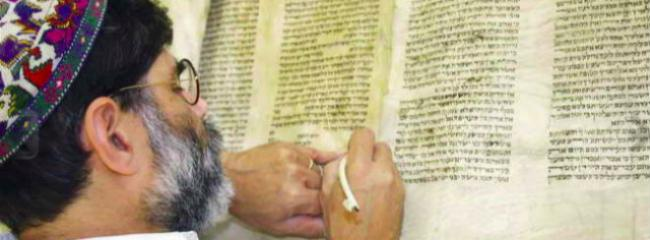 Rabbi Kevin Hale working on a Torah