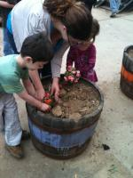Mom, brother and sister planting together